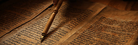 An ancient copy of the Torah being read.