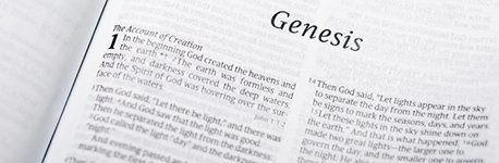 A close up of the book of Genesis.