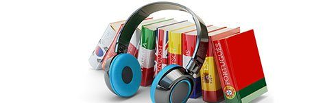 Books with headphones resting against them.