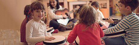 Children learning musical instruments.