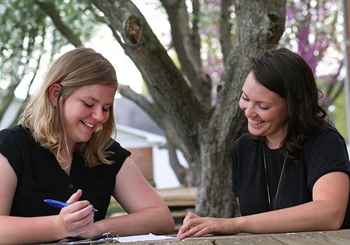 A student receiving academic mentorship.