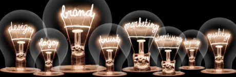 Several stylized lightbulbs with filaments shaped into words.
