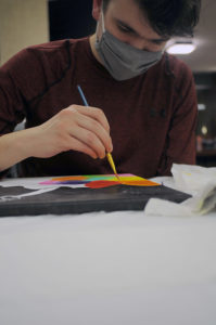 Students painting at new art club