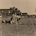 The 1972 soccer team plays on a field located next to the current student union building.