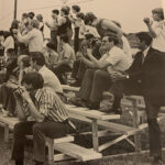 A crowd of fans cheers on the Chargers during a soccer game in 1973. The gentleman on the right of the photo with his hands around his knees is longtime employee Gilbert Gregory, and above him is his son, then-teenager Gordon Gregory—today Dr. Gordon Gregory of the Bible & Theology Department.