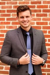 student matthew wiggins in suit