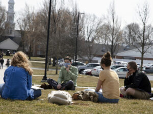 students and professor in outdoor class
