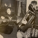 Two students play music in the dorms during the 1970-71 academic year.