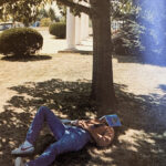 Like all college students have to do at least once in their collegiate lifetime, this student in 1981 is taking a nap under a tree by Esbenshade Hall.