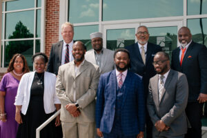 Representatives from PEKBA and LBC   Capital gather in front of the Teague Learning Commons on Aug. 4, 2021.