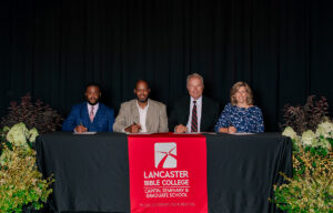 Official signers to the partnership between PEKBA and LBC   Capital included, from left, PEKBA Vice Moderator the Rev. William Scott III, PEKBA Moderator Dr. Wayne Weathers, LBC   Capital Executive Vice President Dr. Lee DeRemer and Provost Tricia Wilson.